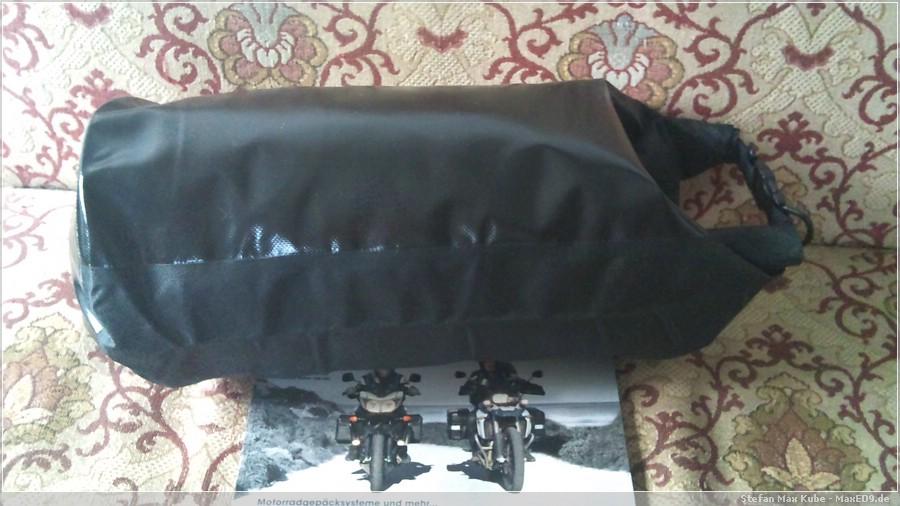 {ops} gefüllter Packsack